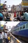 インド、遮断機の下りた踏切を渡る人たち